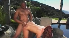 Katja Kassin fingers her pussy while a black cock penetrates her butt