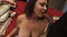 Naughty mature woman with huge tits surrenders her hungry peach to a black cock