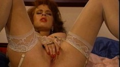 Sarah Jane Hamilton caresses her body and fills her pussy with a dildo