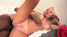 Horny blonde granny Annett satisfies her intense desire for dark meat
