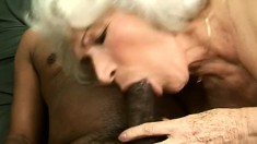 Norma is a naughty granny who enjoys playing with some black cock