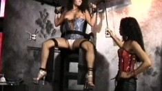 Busty Trisha Post is tied up and tortured by her mistress Lita Young