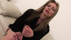 Sultry bombshell Holly Kiss begins a round of seduction on the couch