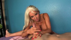 Big Tit Mature Grabs Onto His Pecker And Gives It A Nice Stroking