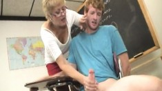 Kinky blonde teacher offers a hung student a fabulous handjob in class