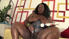 Curvaceous black hottie with huge breasts plays with her favorite toys