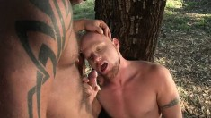 Two hunky dudes wrestle in the mud and suck cocks in a hammock