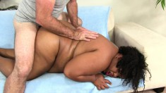 Fat caramel girl with huge breasts welcomes a white shaft up her ass