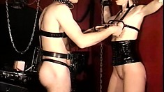 The mistress is torturing the two of them with hooks and biting