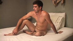 Hot twink Cal Jennings sits on his bed waiting for some excitement