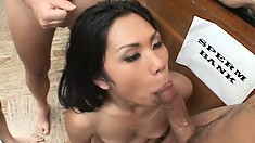 Asian bitch gets on her knees to take on as many cocks as possible