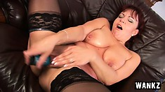 Nika is a redheaded MILF lubing up her pussy to fuck her toy