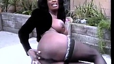 Busty ebony lady in black stockings gets fucked by three guys outside