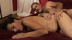 He spoons her then gets on top missionary style and cums on her belly