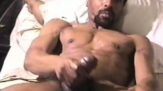 Mega muscled black guy whips out his massive meat in a solo scene