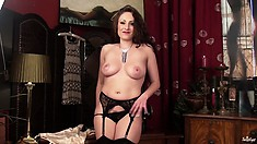 Long-haired milf knows what she will be doing after the long working day