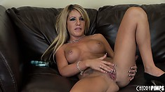 The blonde spreads her body all over the sofa teasing and pleasing her twat