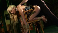 Wild bondage lover Trisha chokes on a long pole and gets drilled rough