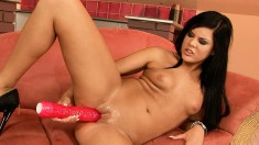 Dark-haired eye candy loves being watched while playing with her black dildo