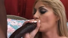 Naughty blonde can't get enough of playing with a black python
