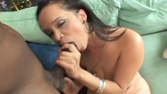 Ebony chick with a big round booty impales herself on a black shaft