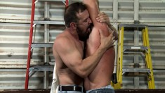 Two hunky handymen strip each other naked for wild gay sex in the shed