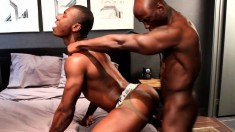 Dark skinned gay lovers indulging in exciting anal action on the bed