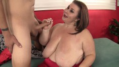 Huge bitch sucks his dick through her tits and fucks on the couch