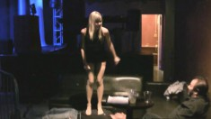 Elegant blonde in a sexy black dress has a guy kissing her lovely feet