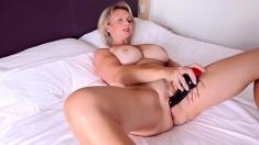 Blonde mature Bridget with big boobs posing