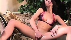 Skinny vixen Veronica Jett stretches her pussy with a glass dildo