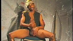 Sitting on a chair, a black hunk jerks his big shaft until it bursts with pleasure