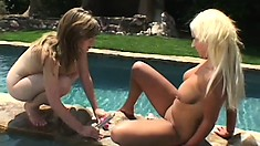 Horny lezzie hotties enjoy some fingering and toying poolside