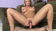 Stacked blonde cougar with a wonderful ass has a stiff cock fucking her holes deep