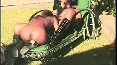 Voluptuous ebony lesbians lick each other's wet cunts outdoors