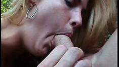 By the pool, a blonde and a brunette take turns fucking a long shaft