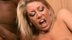 Nasty blonde milf has two black guys fucking her holes at the same time