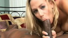 Lustful blonde mom with big tits impales herself on a huge black dick