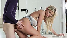 He bangs this hot blonde babe from behind and cums on her ass cheek